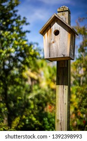 One of several wooden birdhouses in the birdhouse garden at Leu Gardens in Orlando Florida