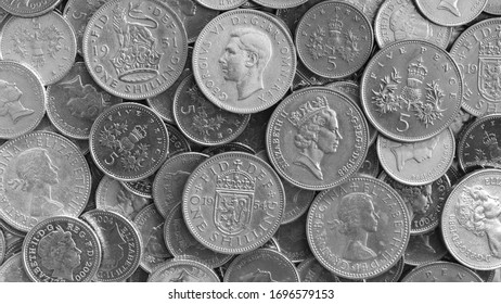 One Shilling coins with profile of King George vi and five pence coins with profile of Queen Elizabeth II