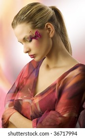one side view of cute woman with closed eyes and creative make up with a butterfly