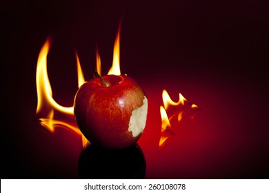 One sinful bite from apple with flames