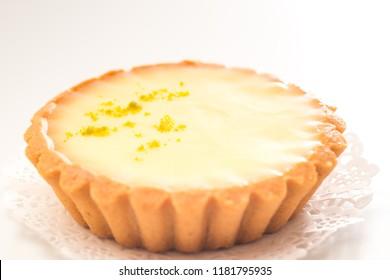 One single lemon tart, isolated on white.