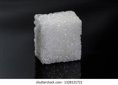 one single piece cube sugar on black background