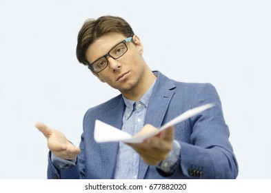 One Sirius young man with glasses give document. Handsome employee in suit  show paper. Selective focus. Student finish his problem.