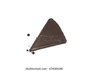 One slice of chocolate cake with crumbs isolated on white background