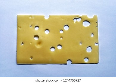One slice of emmental cheese with holes