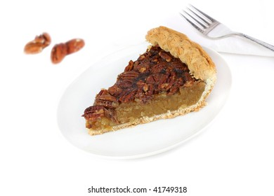 One slice of homemade pecan pie on a white tablecloth with copy space.