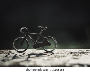 One Small model of bicycle with black and green background, free space
