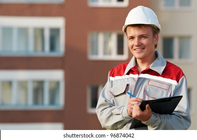 One smiling surveyor worker with clipboard outdoors input the data