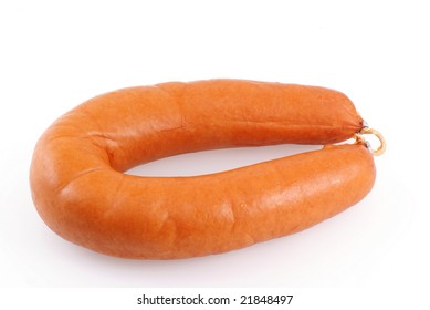 One smoked sausage isolated on a white background.