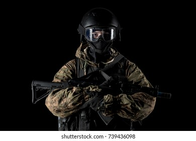 One soldier holding assault rifle. Uniform conforms to special services FSB of the Russian Federation. Shot in studio. Isolated with clipping path on black background