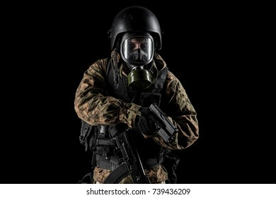 One soldier holding pistol. Uniform conforms to special services FSB of the Russian Federation. Shot in studio. Isolated with clipping path on black background