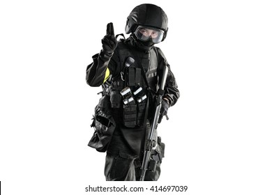 one soldier shows a hand signal and hold in another hand assault rifle ak-74. Uniform conforms to special services FSB of the Russian Federation. Shot in studio. Isolated with clipping path