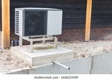 One solitary air conditioning outside on concrete