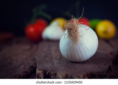 One spring onion in a rustic wooden table