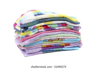 one stack of colorful cloth natural diapers over white