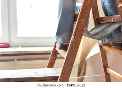 One stands on a ladder during a Renovation