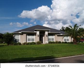 One story Florida home with a stucco facade.
