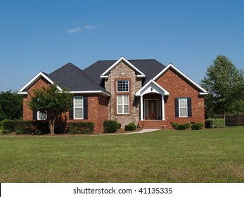 One story new stone and brick residential home.