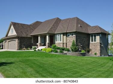 One story rambler house in suburban neighborhood