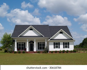 One story residential home with board siding on the facade.