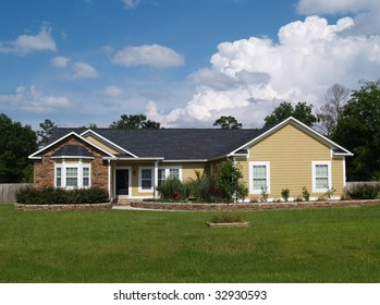 One story residential home with vinyl siding and brick or stone on the facade.
