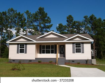One story residential low income home with vinyl siding on the facade.