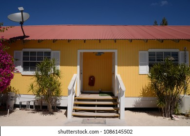 One story yellow house with satellite antenna on it's roof at Bahamas island