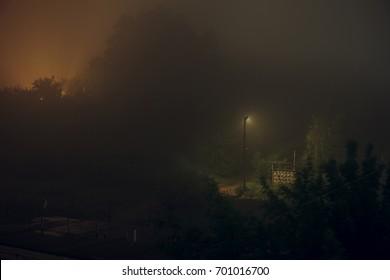 one street lamp in the fog