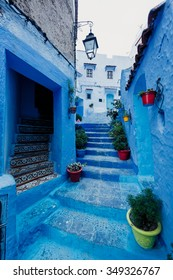 One of the streets in Chefchaouen in Morocco. All the houses and walls are painted blue. Popular tourist destination in Morocco.
