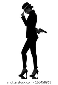 one stylish caucasian woman in suit holding gun in silhouette on white background