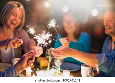 One summer evening, friends in their forties gathered around a table in the garden lit by luminous garlands. They burn sticks of sparks.