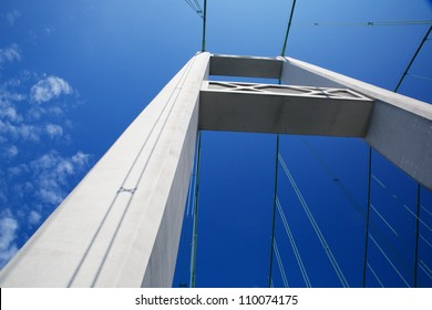 One of the Tacoma narrows bridge Towers against a nearly cloudless blue sky