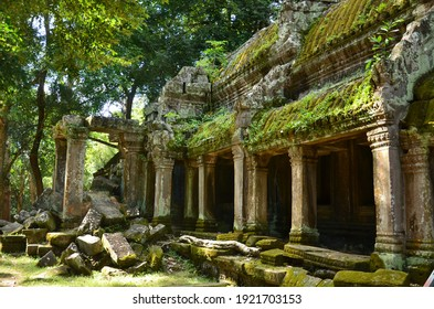 one of the taprom temple buildings with the roof overgrown with moss and grass in Siem Reap, Cambodia, built by King Jayavarman VI