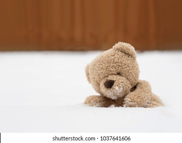 One teddy bear sitting alone on stock photo 100 legal protection one teddy bear sitting alone on snow during winter time a cute brown bear lying altavistaventures Choice Image