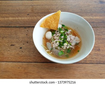 """One of Thai noodle dish, this is call """"Ba mee Tomyam"""" (Name in Thai), egg noodle in the sweet and sour soup. This is a famous noodle in Thailand."""