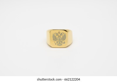 one thick men's gold signet ring with a picture of the double-headed eagle isolated on white background