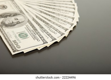 One thousand dollars in fanned hundred dollar bills