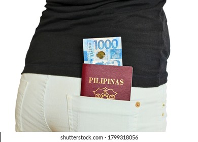 One thousand Filipino pesos bill and Filipino passport in a rear pocket of a traveling woman