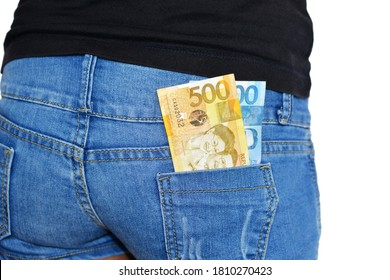 One thousand and five hundred filipino pesos bills out of a rear pocket of a woman's shorts
