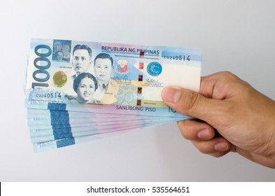 One thousand Philippine peso held by the fingers