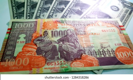 One Thousand Somalia Shilling - Central Bank Of Somalia and One American Dollars Behind - SOS & USD
