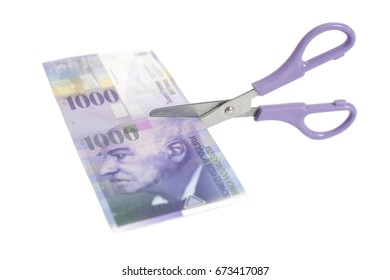One thousand swiss franc banknotes with scissors.currency of switzerland isolated