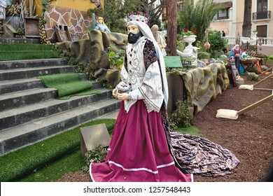 One of the three holy kings in the biblical Christmas story in life-size with magnificent velvet robe. Melchior, the king of Nubia and Arabia, wearing red clothes and brought the precious gold.