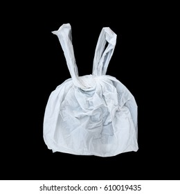 it is one tied white plastic bag isolated on black.