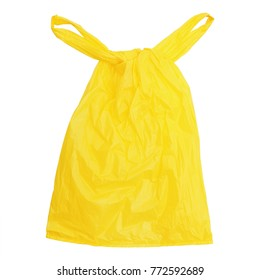 one tied yellow plastic bag isolated on white.
