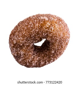 One traditional donut in sugar on a white background. Selective focus.