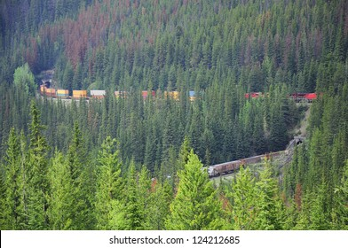 One train moves between Vancouver and Calgary through the famous spiral railway tunnel. Canadian Rockies.