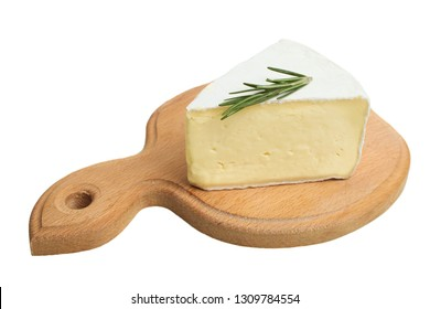 One triangular piece of delicate white Camembert cheese with rosemary on wooden cutting board isolated on white.
