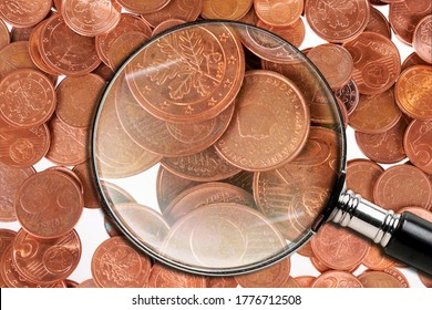 One, two and five euro cent coins under the magnifying glass. End of small change or cash