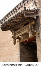 One of the typical wooden carved decorations above the entry doors of Pingyao Ancient City, Shanxi province, China. Pingyao is a UNESCO World Heritage Site